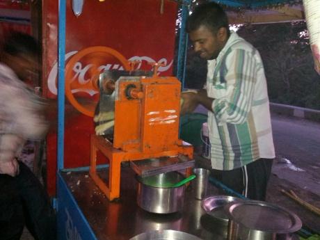 Pressing sugar cane into juice